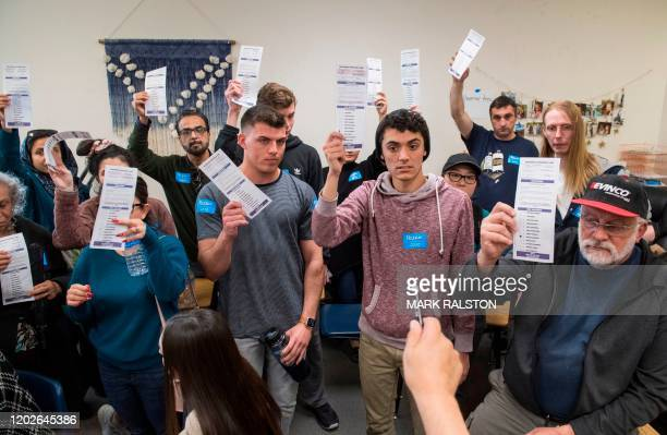 A volunteer counts votes during the Nevada caucuses to nominate a Democratic presidential candidate at the caucus polling station inside the Coronado...