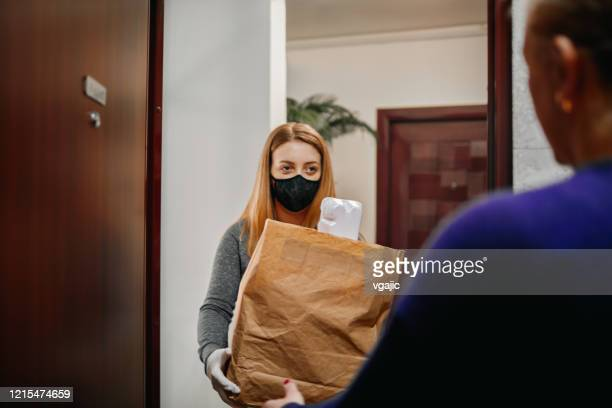 volunteer delivering food to elderly people during lockdown - community care stock pictures, royalty-free photos & images