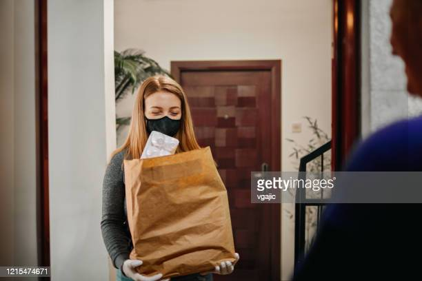 volunteer delivering food to elderly people during lockdown - 18 19 years stock pictures, royalty-free photos & images
