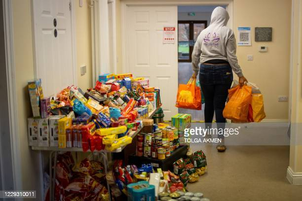 Volunteer delivers donated food packages to the Cooking Champions food bank in Grange Park, north London on October 27 during the novel coronavirus...