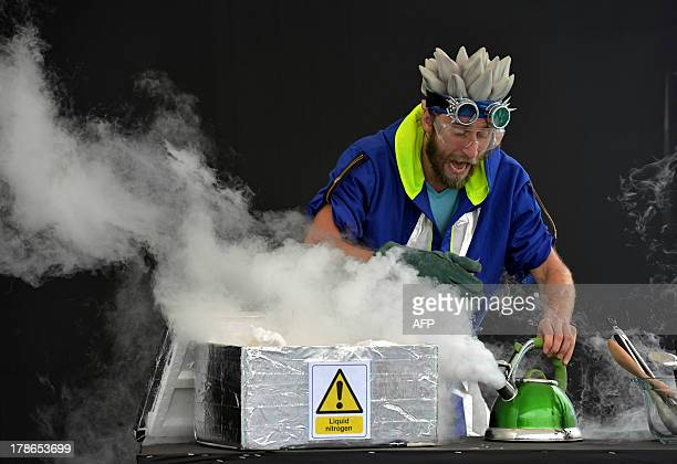 A volunteer demonstrates the chemical qualities of liquid nitrogen to vistors on the inaugural day of the 10day Edinburgh International Science...