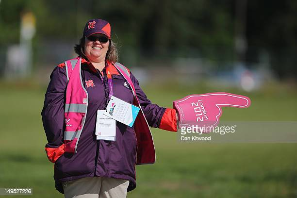 A volunteer directs fans as they arrive the Greenwich Park Equestrian venue on July 30 2012 in London England London's transport infrastructure is...