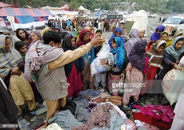 A volunteer distributes winter cloths to Kashmiri earthquake survivors in Muzaffarabad the capital of Pakistani administrated Kashmir 10 November...