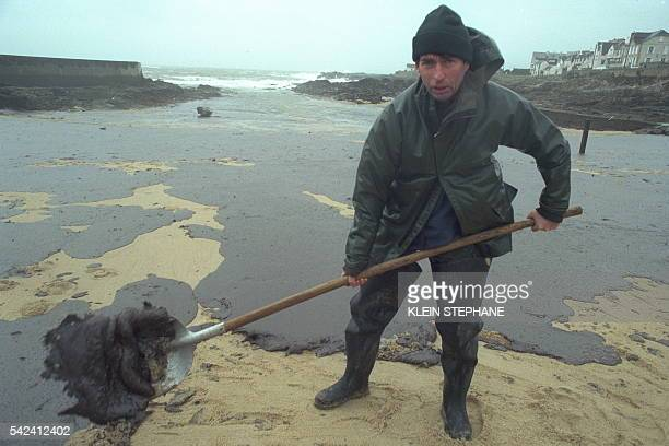 A volunteer does what he can to clean a beach near Le Croisic