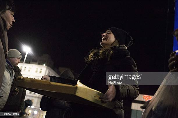 Volunteer during Christmas Eve dinner for homeless persons made by quotDaj Herbatequot foundation near Central Railway Station in Warsaw Poland on...