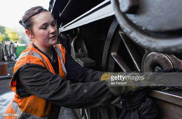 Volunteer Emma Mountain carries out maintenance on a steam locomotive in the Grosmont railway sheds at the North Yorkshire Moors Railway on September...