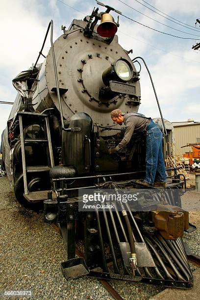 Volunteer Eric Cook who works as a paralegal during the week works on the front of the Santa Fe 3751as volunteers from the San Bernardino Railroad...