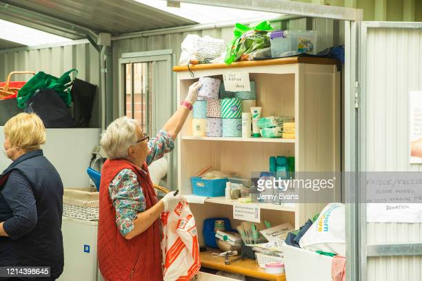 Volunteer Felicity Baker picks up a toilet roll at St Paul's Anglican Church in Burwood on March 24 2020 in Sydney Australia The Parish Pantry...