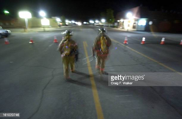 GRANBY CO JUNE 05 2004 Volunteer fire fighters Travis Kesterson and Andy Meadows deliver lighting equipment to emergency workers while holding a...