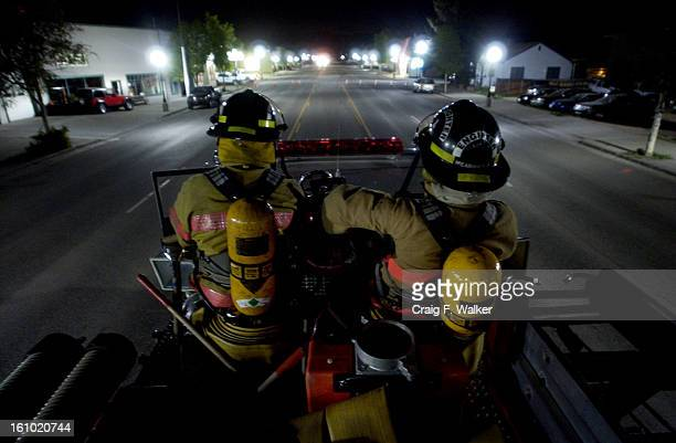 GRANBY CO JUNE 05 2004 Volunteer fire fighters Travis Kesterson and Andy Meadows sit atop a pumper truck while holding a position on the perimeter on...