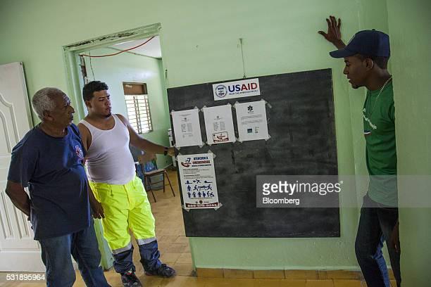Volunteer firefighters and emergency medical technicians speak inside the Manzanillo Fire Department in Manzanillo Monte Cristi Province Dominican...