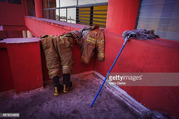 A volunteer firefighter's equipment lies out to dry at the station January 17 2014 in Guatemala City Guatemala The bomberos voluntarios are a...