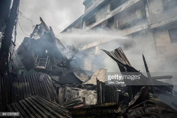 Volunteer firefighters respond to a massive fire in Tondo, Manila.