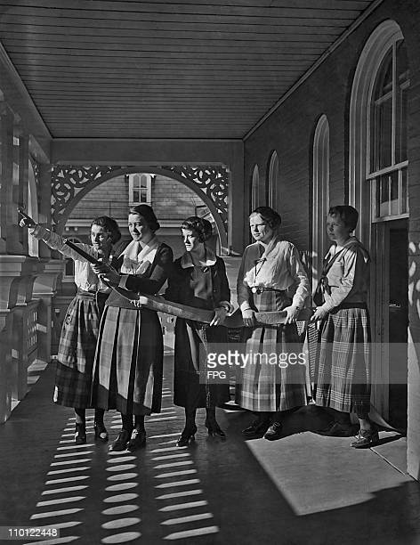 A volunteer firefighting team of female students with a hose at Wilson College Chambersburg Pennsylvania circa 1920