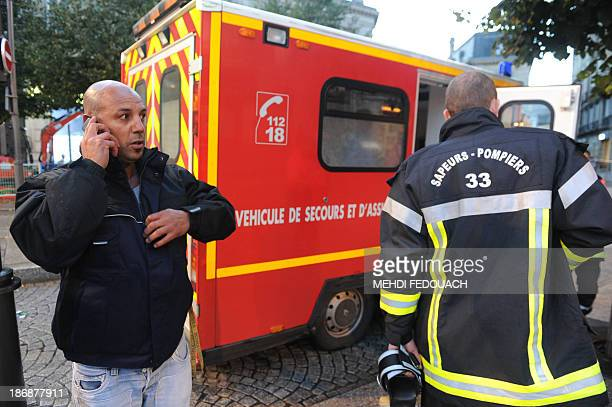 Volunteer fireman Aziz speaks on a mobile phone at the 'Victoire' tramway station in Bordeaux southwestern France on November 4 after a 24yearold...