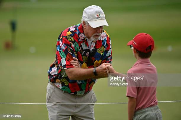 Volunteer fist bumps a participant during the 2021 Drive, Chip and Putt Regional Qualifier at TPC Scottsdale on September 26, 2021 in Scottsdale,...