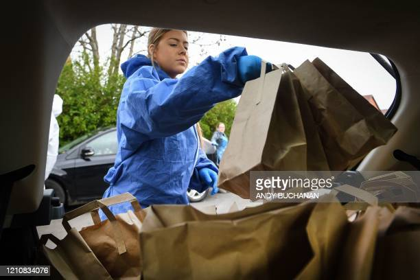 Volunteer for Social Bite social enterprise Laura Corolla loads packed lunches that will be distributed for free to homeless, vulnerable and needy...
