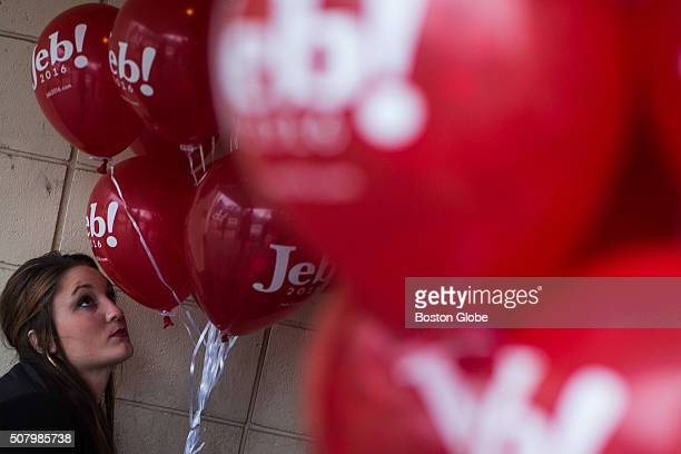 A volunteer for US Republican Presidential candidate Jeb Bush looks at balloons during a campaign rally at the Alpine Club in Manchester NH Feb 1 2016