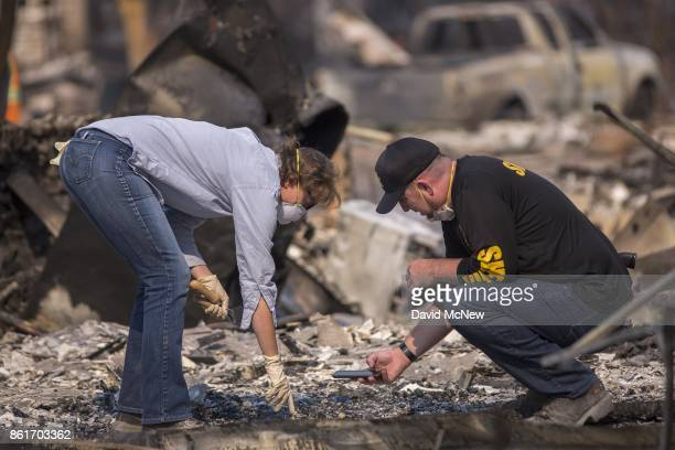 Volunteer forensic anthropologist Alexis Boutin, from Sonoma State University, and a sheriff deputy investigate bones found by California National...