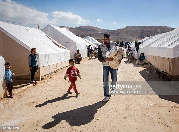 A volunteer from a Lebanese nongovernmental organisation one of three currently operating relief groups in the eastern Lebanese town of Arsal after...