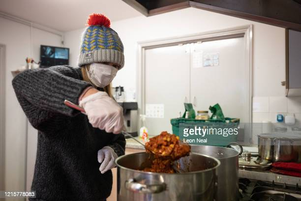A volunteer from Ealing Soup Kitchen prepares food parcels for clients on March 30 2020 in Ealing England Like many other countries around the world...