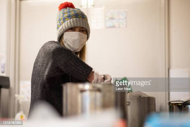 Volunteer from Ealing Soup Kitchen prepares food parcels for clients on March 30, 2020 in Ealing, England. Like many other countries around the...