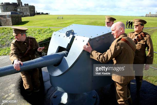 Volunteer gun crew firing the Edwardian 12 pounder on March 28 2018 in Falmouth England English Heritage are warning that many of the historic...