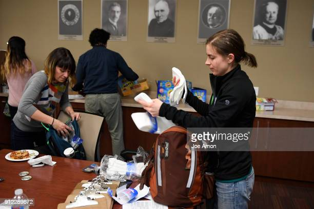 Volunteer Gwynneth Johnson from Colorado Coalition for the Homeless packing socks before heading out into the streets for the annual Point in Time...