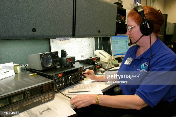 A volunteer ham radio operator communicating with those in path of Hurricane Ivan