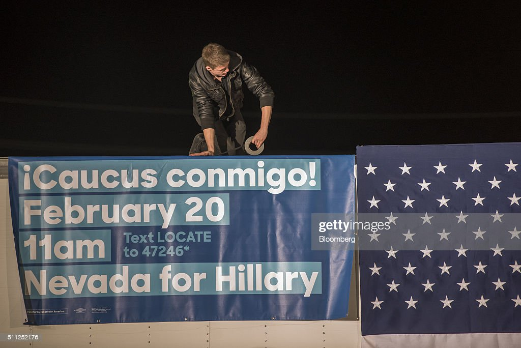 A volunteer hangs a banner prior to the arrival of Hillary Clinton, former Secretary of State and 2016 Democratic presidential candidate, during a campaign rally at the Laborers International Union in Las Vegas, Nevada, U.S., on Thursday, Feb. 18, 2016. Polling suggests Clinton is in danger of being overtaken by Sanders, a Vermont senator and self-described democratic socialist when the Nevada caucuses are held on February 20. Photographer: David Paul Morris/Bloomberg via Getty Images