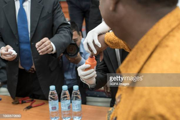 A volunteer has his finger tinted to demonstrate how permanent the ink is The new indelible ink has been presented today that will be used on July...