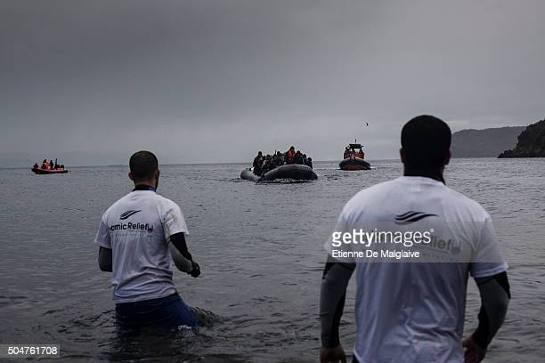 Volunteer helpers from Belgium Islamic Relief NGO prepare to assist an incoming refugees dinghy escorted by two rescue boats Refugees from...
