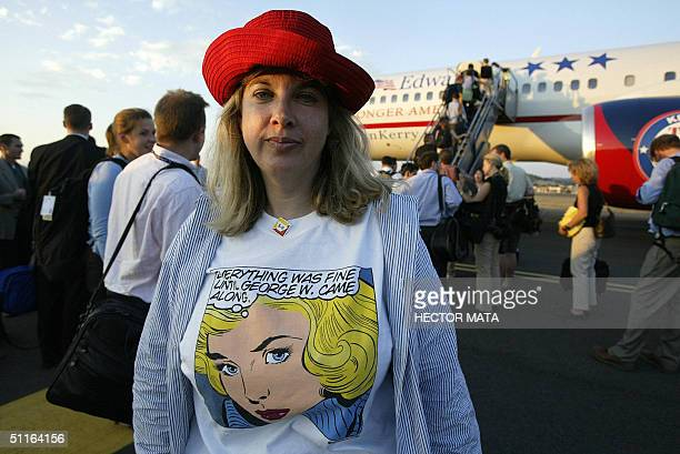 A volunteer helping on Democratic Presidential Candidate John Kerry's campaign stands in front his plane in Medford Oregon 12 August 2004 AFP PHOTO /...
