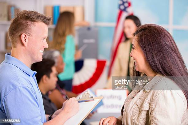 volunteer helps people register to vote in november usa elections. - election stock pictures, royalty-free photos & images