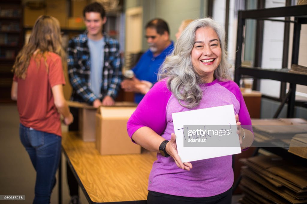 Volunteer Holding a Sign : Stock Photo