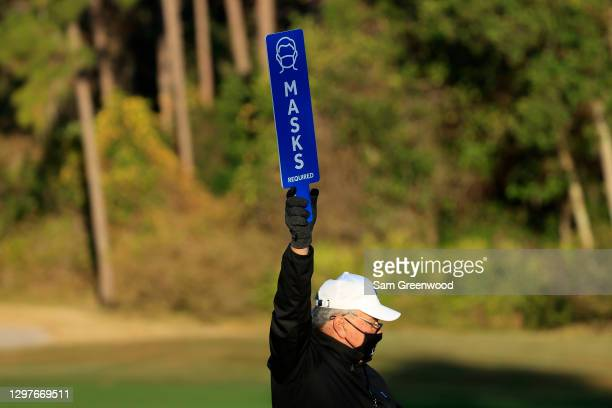 Volunteer holds a sign during the first round of the Diamond Resorts Tournament Of Champions at Tranquilo Golf Course at the Four Seasons Golf and...