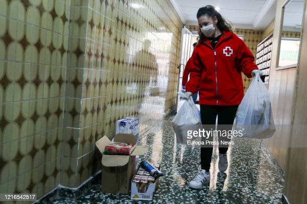 A volunteer is seen delivering food as the Town Hall Civil Protection and volunteers of the Red Cross at the town of Mistala give food to needy...