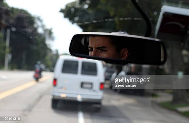 Volunteer is seen in the rearview mirror of a press vans as the motorcade of Republican presidential candidate and former Massachusetts Gov. Mitt...
