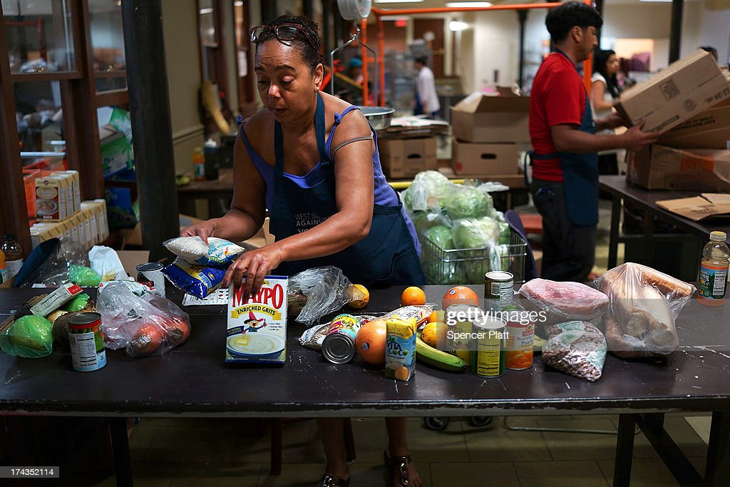Volunteer Iysabel Rodriguez sorts food at the West Side Campaign Against Hunger food pantry on July 24, 2013 in New York City. The food pantry assists thousands of qualifying New York residents in providing a monthly allotment of food. In an anticipated speech today in Illinois, President Obama tried to re-focus the nations attention back onto the economy and the growing inequality between the rich and the rest of America. As of May 2013 the unemployment rate in America was stuck at 7.6% with many more Americans having given up on looking for work.