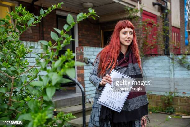 Volunteer Jessica Kleczka poses after posting leaflets for a local community support group called Mutual Aid through letter boxes on a housing estate...