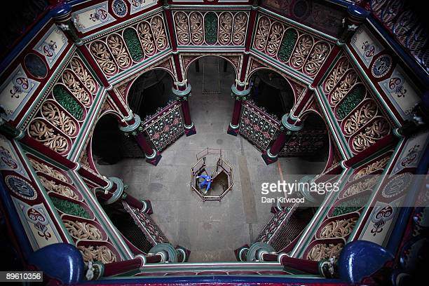 Volunteer Jill Wilkinson polishes the iron staircase leading up to the main pumping room at the The Crossness Pumping Station on August 4 2009 in...