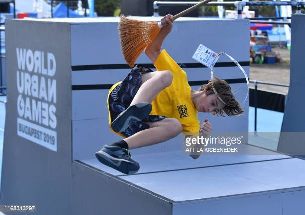 A volunteer jumps a somersault on the stage after the women's competition of the Parkour free style category in the World Urban Games of Budapest...