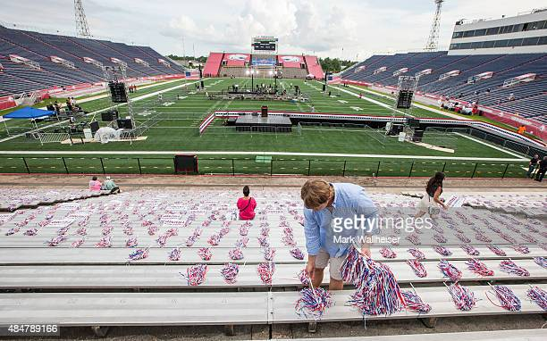 Volunteer Kyler King from Hazel Green Alabama lays out pom poms prior to the arrival of Republican presidential candidate Donald Trump for a rally at...