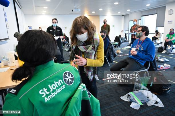 Volunteer learns how to administer an injection during a vaccinator training day lesson ran by the St John's Ambulance in Canary Wharf, east London,...