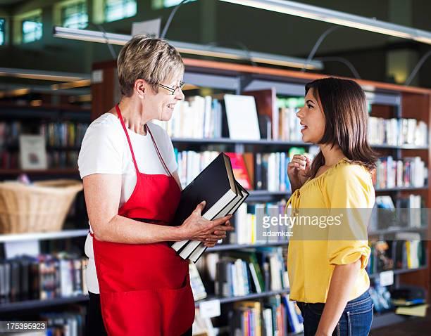 Volunteer Librarian Helping Student
