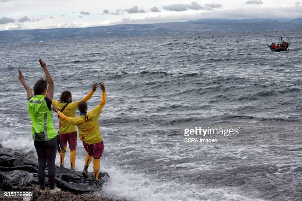 Volunteer lifeguards from the Spanish NGO Proactive Open Arms help direct asylumseekers arriving by boat to a safe landing area In 2015 more than a...