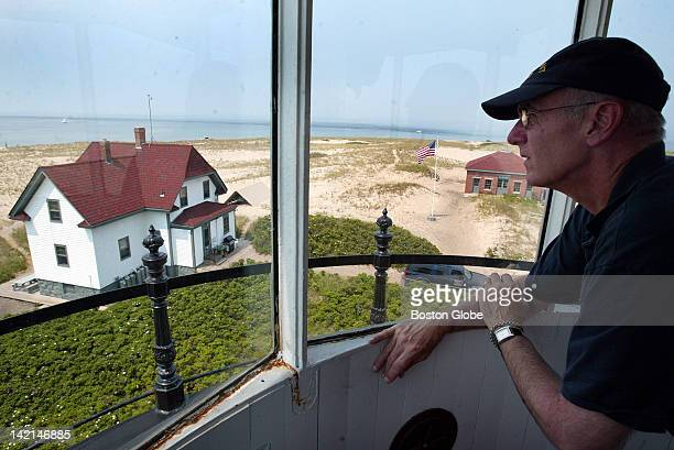Volunteer light keeper Brian Larkin who along with his wife Jan Larkin tend Race Point Light takes in the view from the lighthouse tower The house...