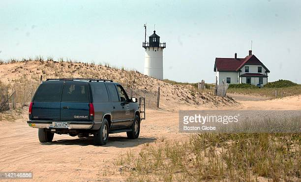 Volunteer light keeper Brian Larkin who along with his wife Jan Larkin tend Race Point Light drives the four wheel drive vehicle through the sandy...