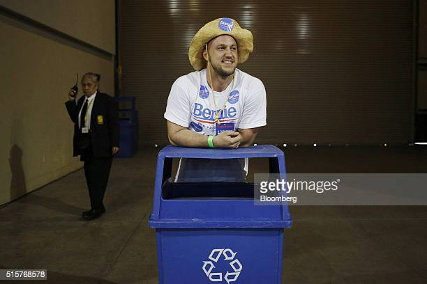 A volunteer listens to preprogram speakers during a campaign event for Senator Bernie Sanders an independent from Vermont and 2016 Democratic...
