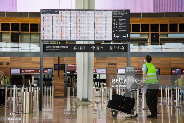 Volunteer looks at a display with flight information during a test run at Berlin Brandenburg Airport 'Willy Brandt' ahead of its opening, planned for...